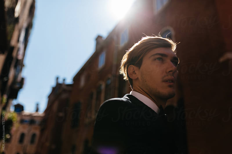 Elegant Young Man Walking in Venice Italy by HEX . for Stocksy United