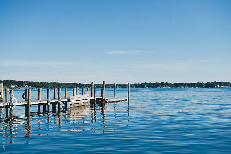 Wooden dock and water by Lauren Naefe for Stocksy United