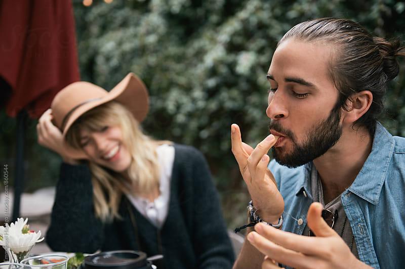 Finger lickin' good by Emmanuel Hidalgo for Stocksy United
