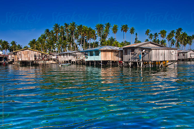 Sea gypsy water village on remote tropical island by Søren Egeberg Photography for Stocksy United