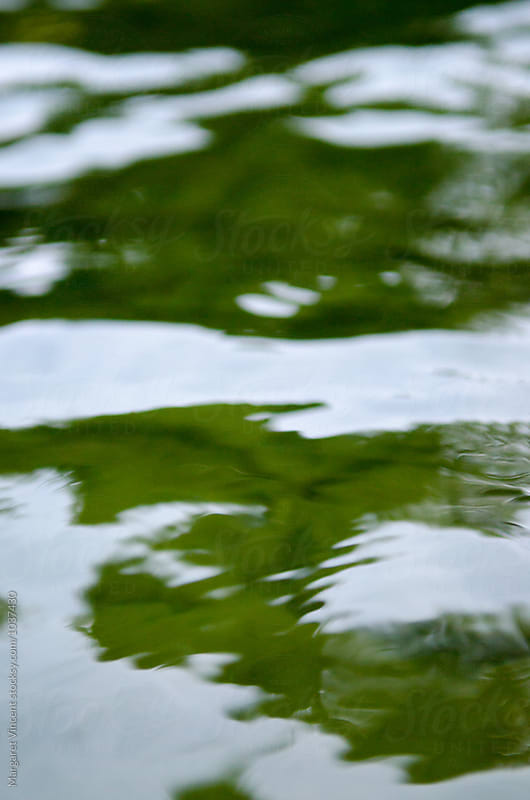 abstract ripples on a freshwater lake by Margaret Vincent for Stocksy United