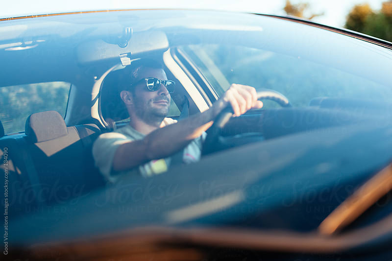 Man driving a car by Good Vibrations Images for Stocksy United