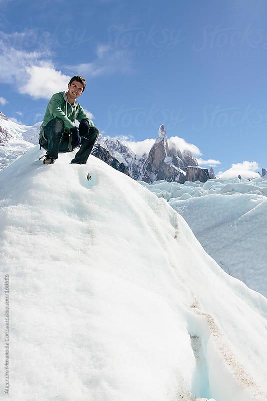 Young man on a glacier in Patagonia by Alejandro Moreno de Carlos for Stocksy United