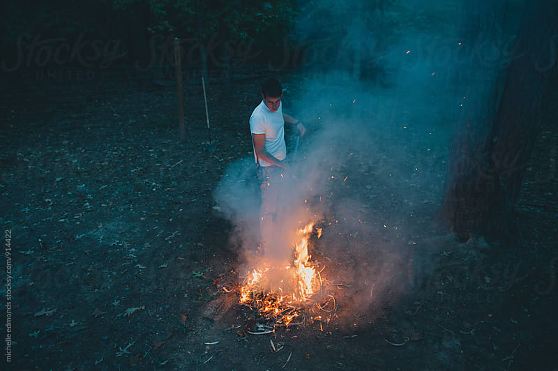 Man Building a Fire by michelle edmonds for Stocksy United