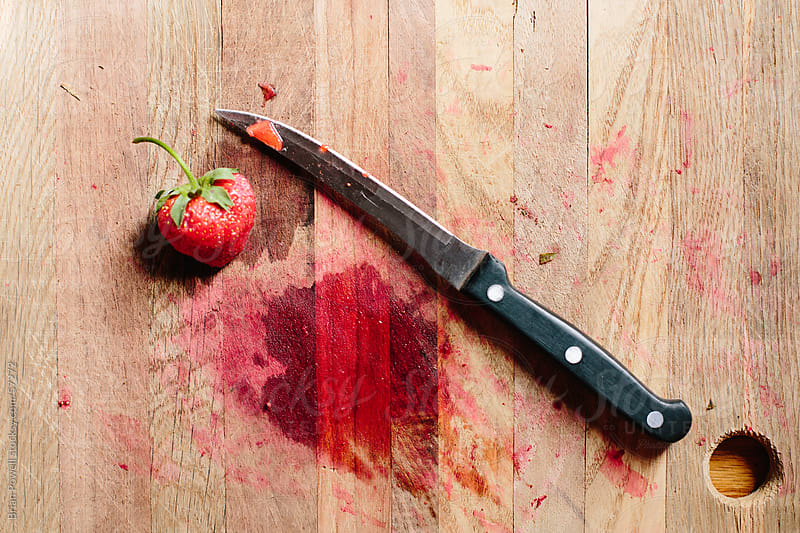 knife and strawberry on cutting board by Brian Powell for Stocksy United
