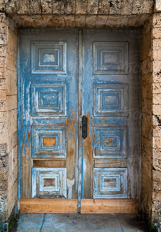 Blue weathered door by Pixel Stories for Stocksy United