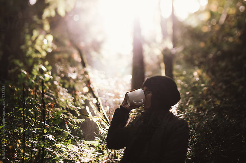 Woman drinking coffee outdoors by Isaiah & Taylor Photography for Stocksy United