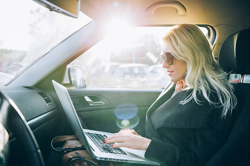 Woman With a Laptop in a Car by Lumina for Stocksy United