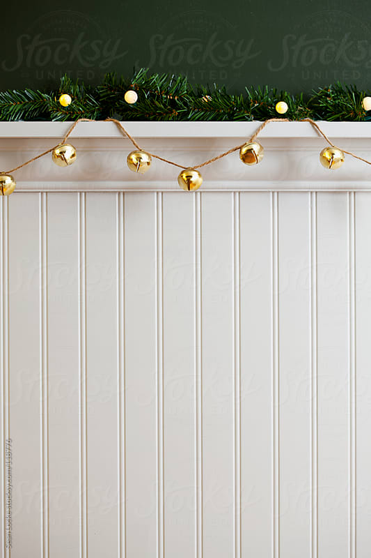 Holidays: Brass Bell Decorations Hanging With Garland by Sean Locke for Stocksy United
