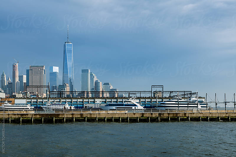 Manhattan Financial District in a Summer Day Viewed From Hudson River by VICTOR TORRES for Stocksy United