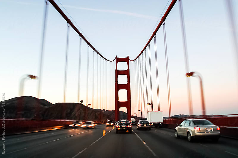 Driving across Golden Gate Bridge San Francisco, California by Raymond Forbes LLC for Stocksy United