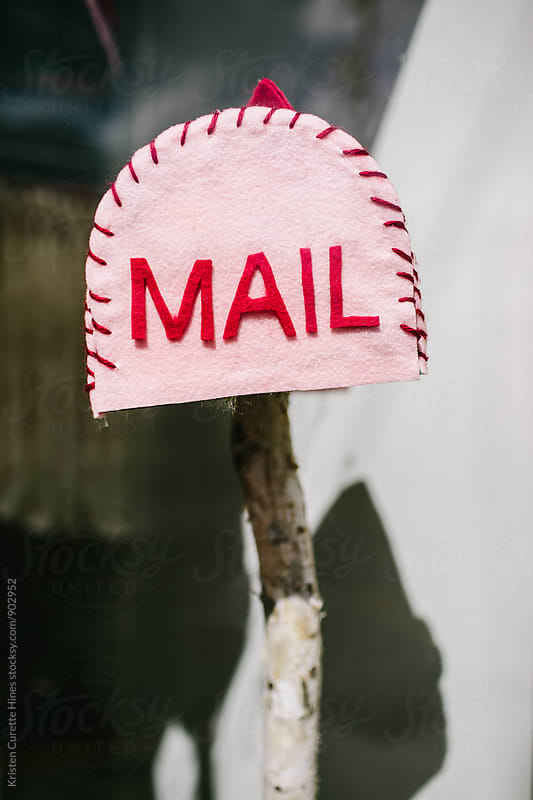 Homemade pink mailbox  by Kristen Curette Hines for Stocksy United
