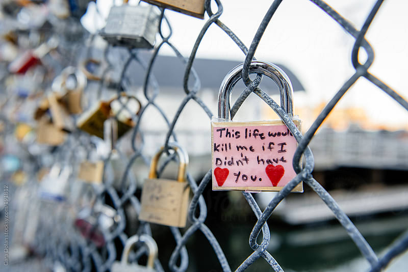Love locks on a chain link fence by Cara Dolan for Stocksy United
