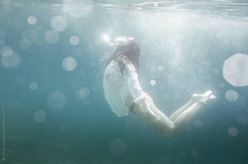 Woman Diving in a White Shirt by Branislav Jovanović for Stocksy United