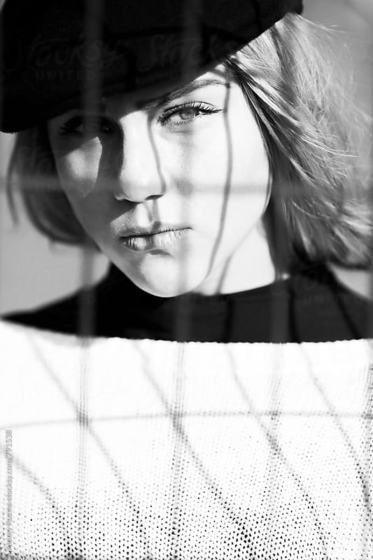 cool young woman with black cap by Alexey Kuzma for Stocksy United