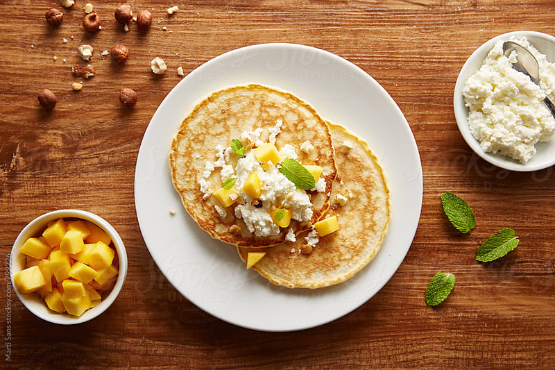 Peach, cottage cheese and mint pancakes by Martí Sans for Stocksy United