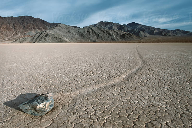 Death Valley Sailing Stones by Casey McCallister for Stocksy United
