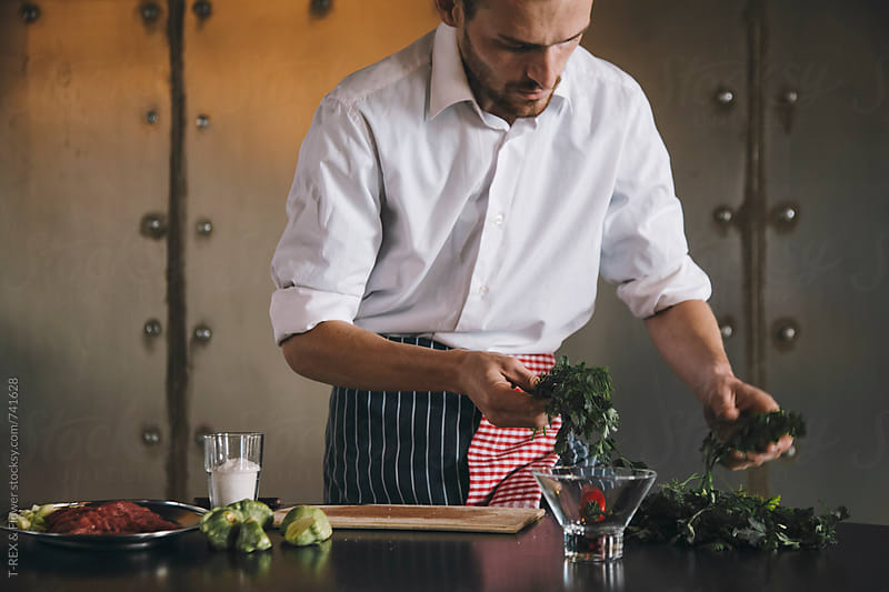 Chef choose greenery at kitchen by Danil Nevsky for Stocksy United