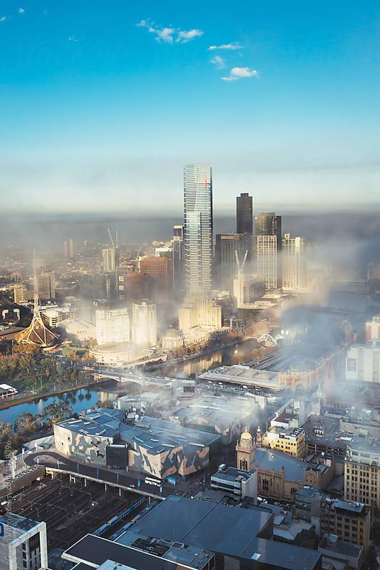 morning view of Melbourne city shrouded in fog by Gillian Vann for Stocksy United