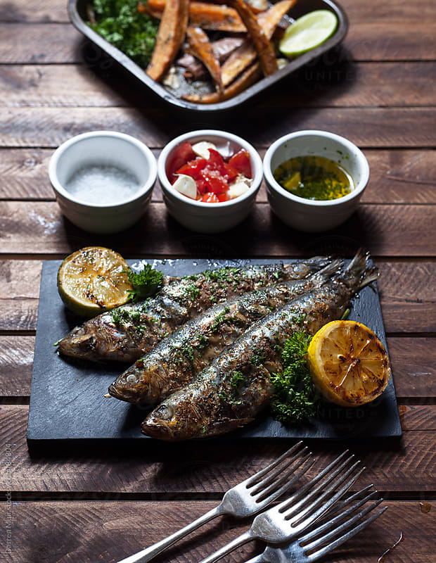 Grilled sardines.  by Darren Muir for Stocksy United