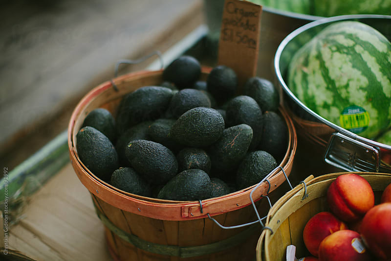 Avocados at Farmer's Market by Christian Gideon for Stocksy United