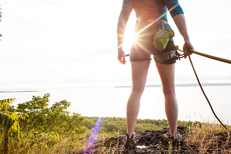 Anonymous Fit Female Rock Climber Rock Climbing at Sunrise by JP Danko for Stocksy United