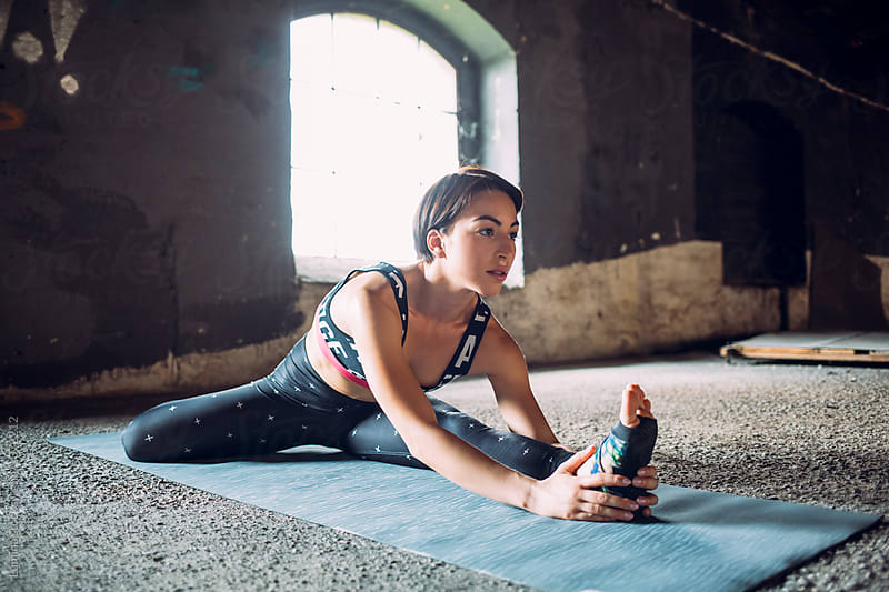Woman Doing Exercise on the Floor by Lumina for Stocksy United