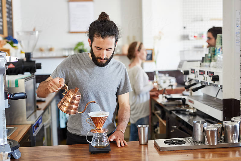 Barista making alternative coffee in chemex by Martí Sans for Stocksy United
