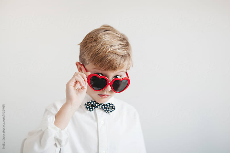 handsome boy wearing valentine's sunglasses by Kelly Knox for Stocksy United