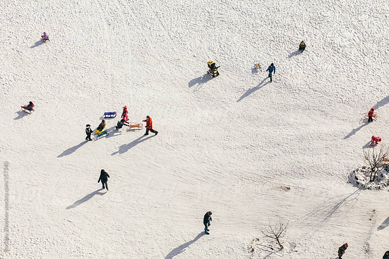 Kids playing at cold winter day in the snow by Borislav Zhuykov for Stocksy United