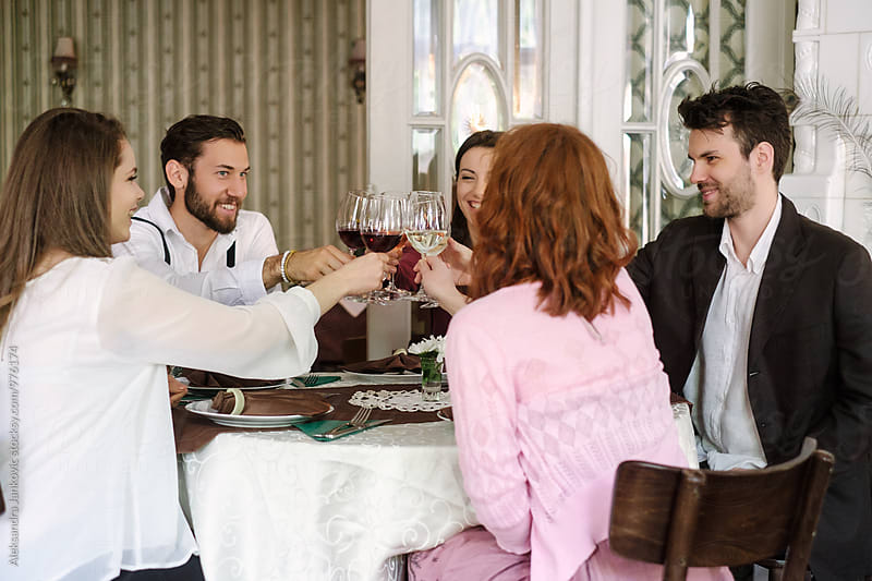 Group of Friends Making a Toast at the Restaurant by Aleksandra Jankovic for Stocksy United