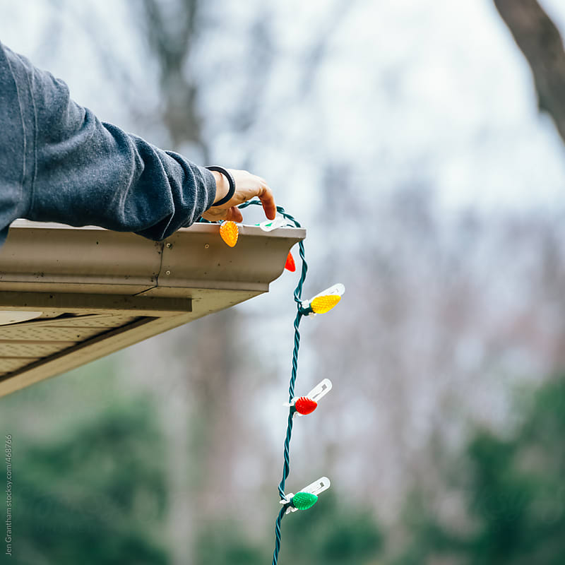 Putting up the Christmas Lights by Jen Grantham for Stocksy United