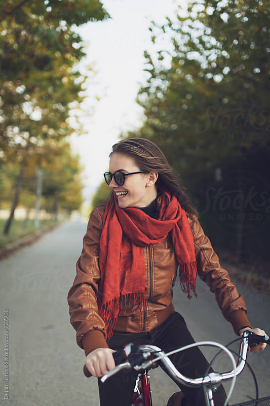 Girl riding a bike by Dejan Ristovski for Stocksy United