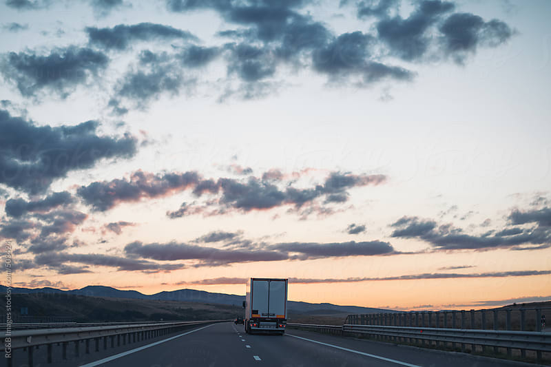 truck on highway by RG&B Images for Stocksy United