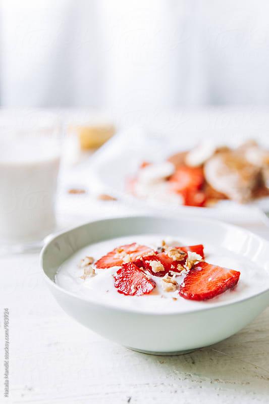 Yogurt with strawberries and walnuts by Nataša Mandić for Stocksy United