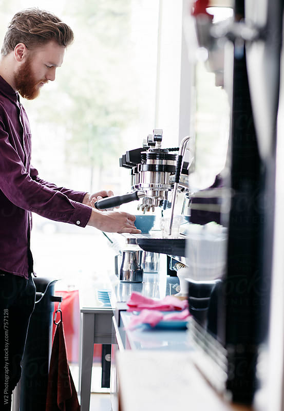 Barista working on an espresso machine. by W2 Photography for Stocksy United