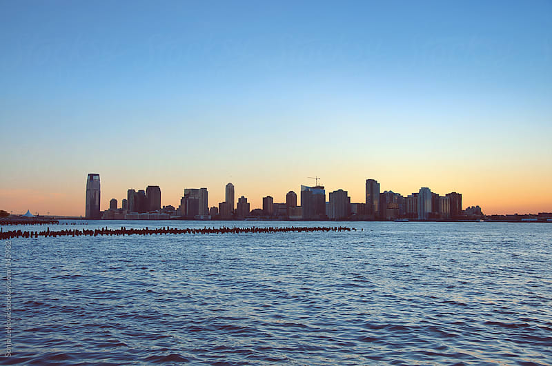 new york cityscape on the water by Sonja Lekovic for Stocksy United