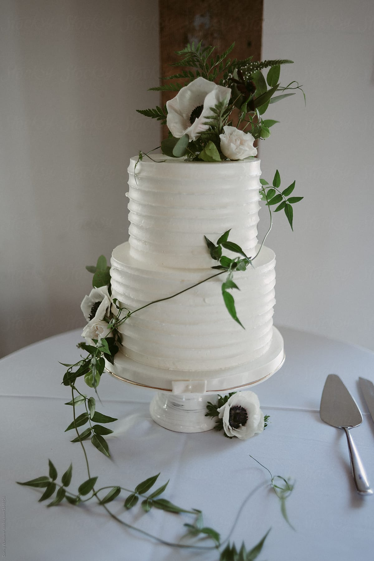 White Icing Wedding Tiered Wedding Cake With Vines And Simple White