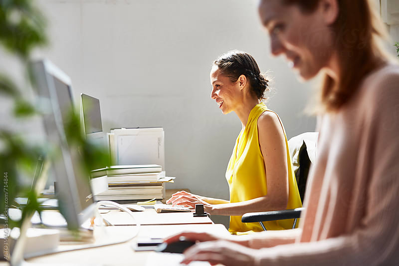 Businesswomen Using Computers In Office by ALTO IMAGES for Stocksy United