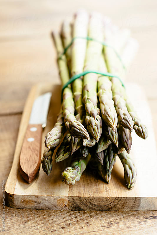 Green asparagus by Harald Walker for Stocksy United