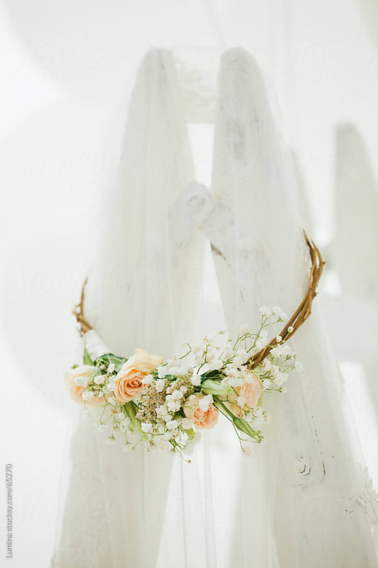 Bridal Veil and Flower Wreath on a Ladder by Lumina for Stocksy United