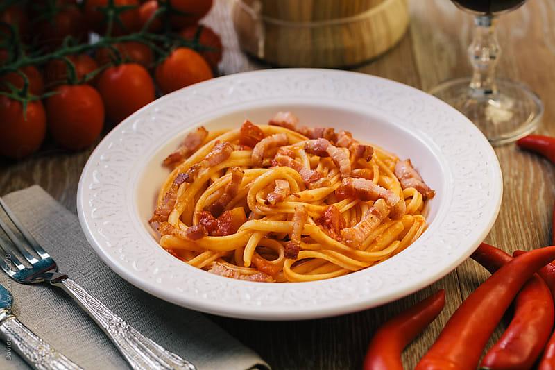 Spaghetti amatriciana by Davide Illini for Stocksy United