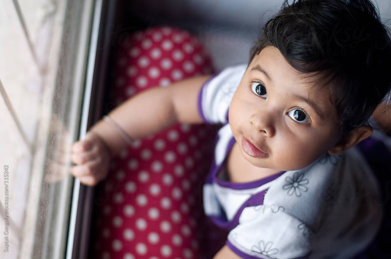 Cute baby girl looking up by Saptak Ganguly for Stocksy United