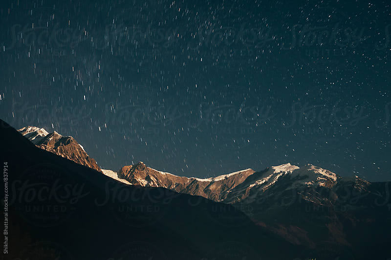 Stars on a clear night sky above the himalayas. by Shikhar Bhattarai for Stocksy United