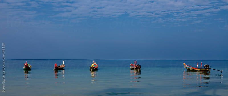 Blue ocean panorama with flat sea and small boats on the horizon by Soren Egeberg for Stocksy United