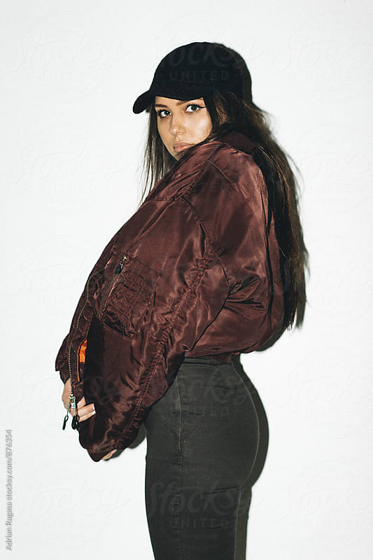 Woman in Hat & Bomber Jacket by Adrian Ragasa for Stocksy United
