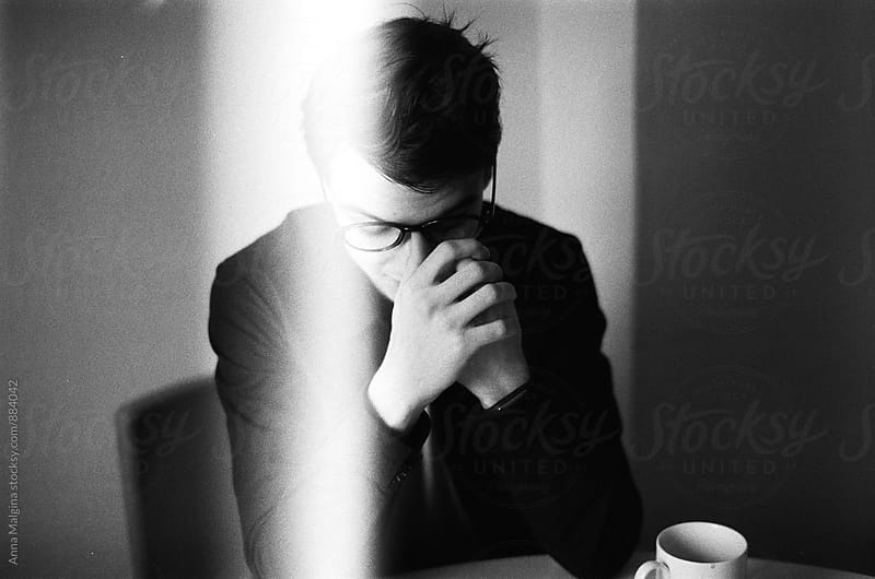 A black and white film portrait of a young beautiful man by Anna Malgina for Stocksy United