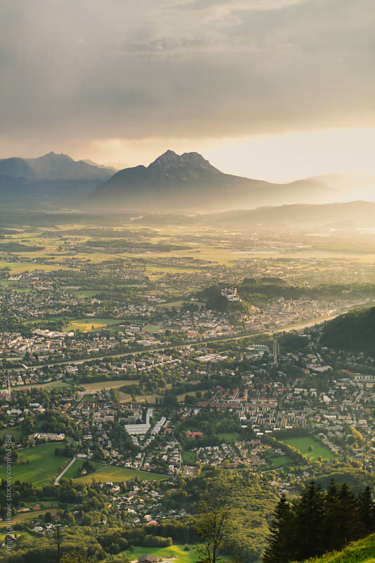 Salzburg at sunset by Amir Kaljikovic for Stocksy United