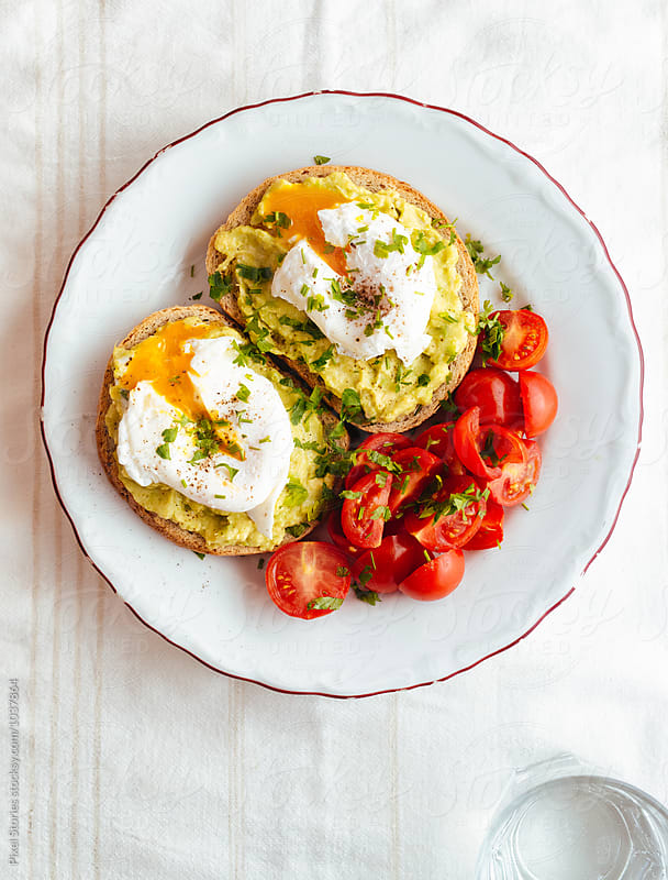 Sunny side up avocado toast breakfast by Pixel Stories for Stocksy United