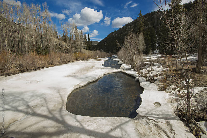 Creek in the snow by Brian Koprowski for Stocksy United